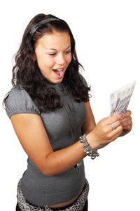 Thrilled teenage girl with money
