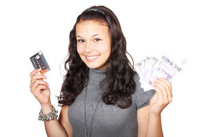 Woman with credit card and money