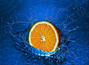 Fresh orange splash in water