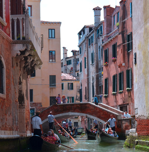 Gondolas in canal of Venice