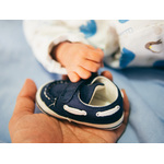 Small baby shoe in hands