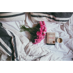 Pink bouquet on a bed