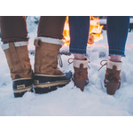 Male and female shoes in snow