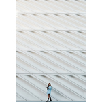 Girl in front abstract white wall
