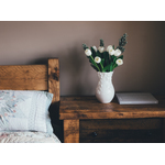 White tulips on nightstand