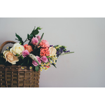 Roses and other flowers in basket