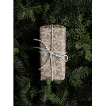 Wrapped present on pine