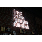 Light sign on brick wall