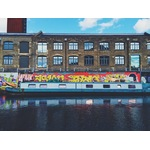 Boat in front of graffiti wall