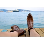 Boots by the water