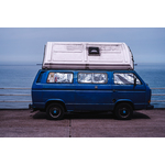 Blue van by the ocean