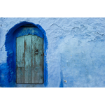Blue wall with wooden door
