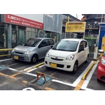 Three japanese cars on parking