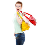 Surprised woman carrying bags